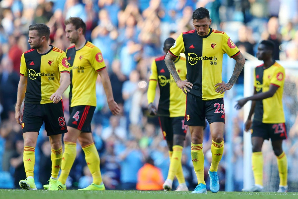 Watford players look dejected after their 8-0 defeat in the Premier League match between Manchester City and Watford FC at Etihad Stadium. (Getty Images)