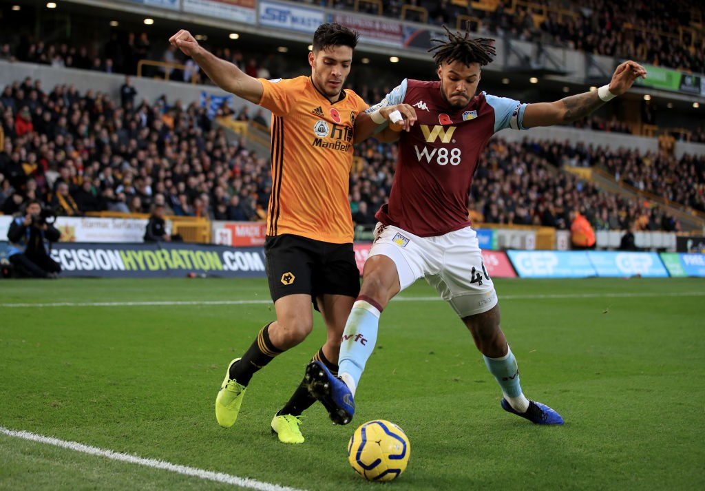 Mings engages in a tussle with Wolverhampton Wanderer's forward Raul Jimenez during a Premier League game.