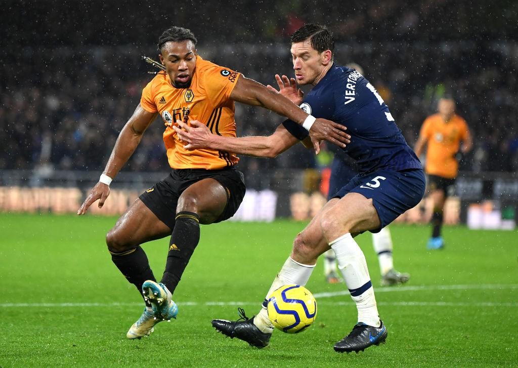Traore tries to dribble past Tottenham Hotspur defender Jan Vertonghen.