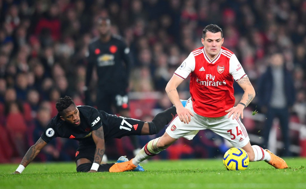 Xhaka fights for the ball against Manchester United's midfielder Fred last Wednesday.