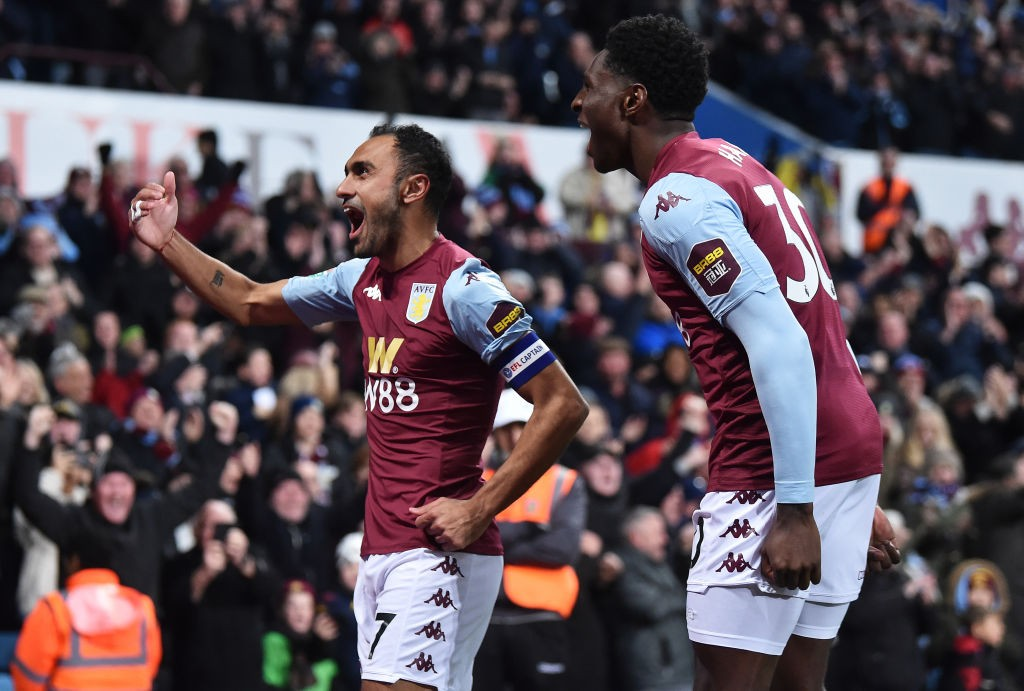 Aston Villa players celebrate after scoring a goal.