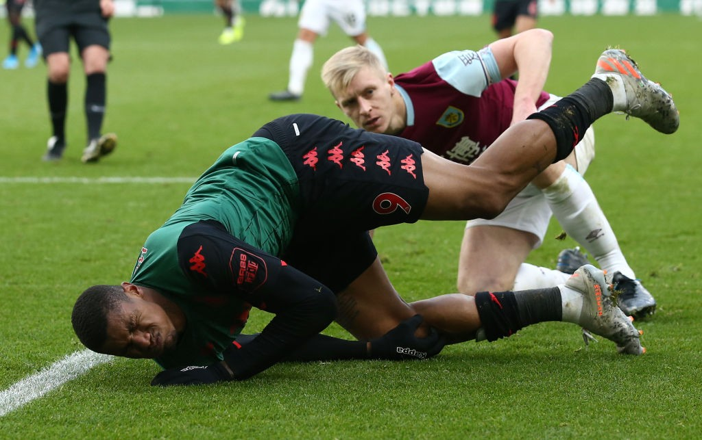 Aston Villa's Wesley (left) falls down on the ground after injuring his knee in the Premier League game against Burnley.