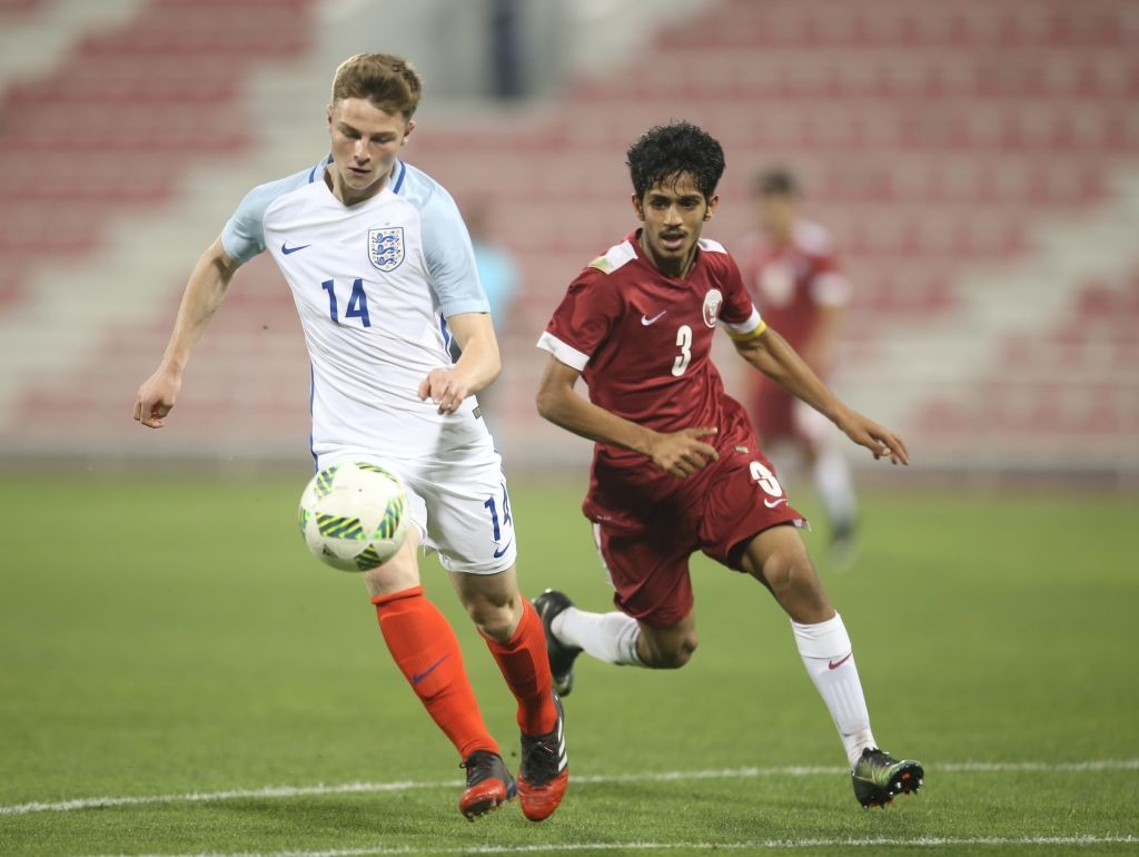 George Tanner of England in action against Ahmed Minhali of Qatar during the U18 International friendly match between Qatar and England at the Grand Hamad Stadium on March 27, 2017 in Doha, Qatar. (Getty Images)