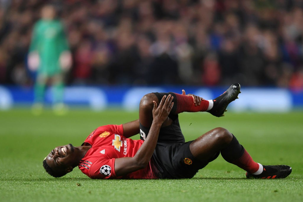United's Pogba seen lying down after getting injured during a Champions League game.