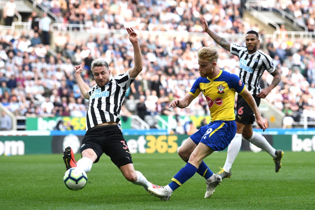 Sims tries a shot during a Premier League game against Newcastle United.