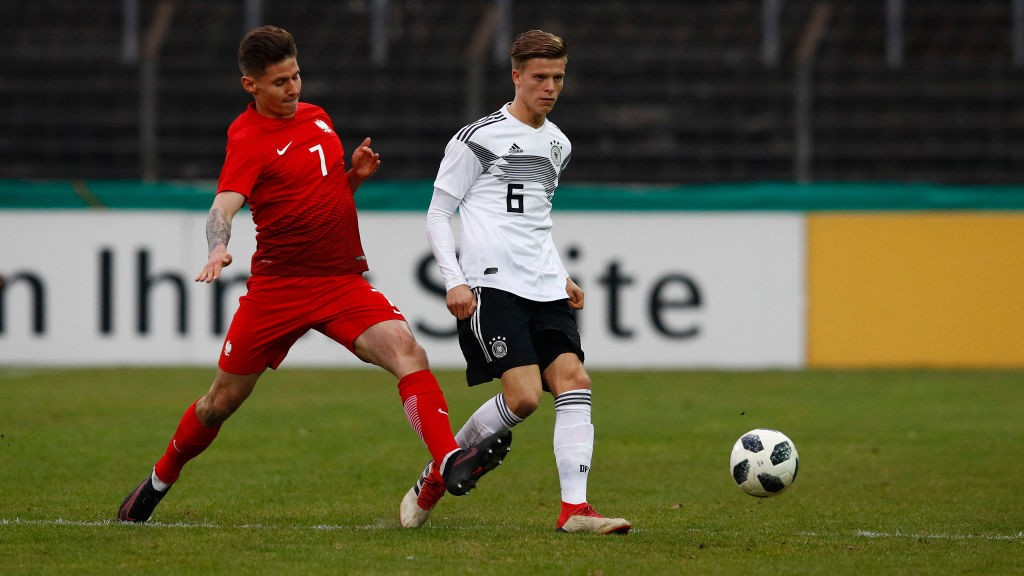Dzenis Burnic of Germany challenges Patryk Klimala of Poland during the international friendly match between U20 Germany and U20 Poland at Energieversum Stadion im Heidewald on March 27, 2018 in Guetersloh, Germany. (Getty Images)