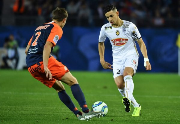 Angers' French defender Rayan Ait-Nouri (R) fights for the ball with Montpellier's French defender Arnaud Souquet (L) during the French L1 football match between Montpellier Herault SC and Angers SCO at the Mosson stadium in Montpellier, southern France on October 26, 2019. (Getty Images)