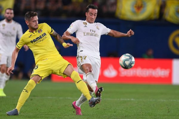 Villarreal's Spanish defender Xavi Quintilla (L) challenges Real Madrid's Spanish forward Lucas Vazquez during the Spanish league football match Villarreal CF against Real Madrid CF at La Ceramica stadium in Vila-real on September 1, 2019. (Getty Images)