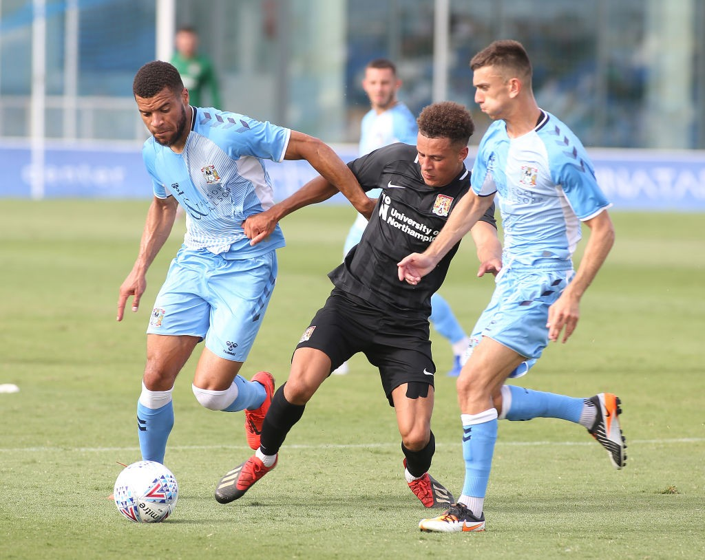 Shaun McWilliams of Northampton Town attempts to move between Max Biamou and Zain Westbrooke of Coventry City during a Pre-Season Friendly match between Northampton Town and Coventry City at Pinatar Arena on July 12, 2019 in Murcia, Spain. (Getty Images)